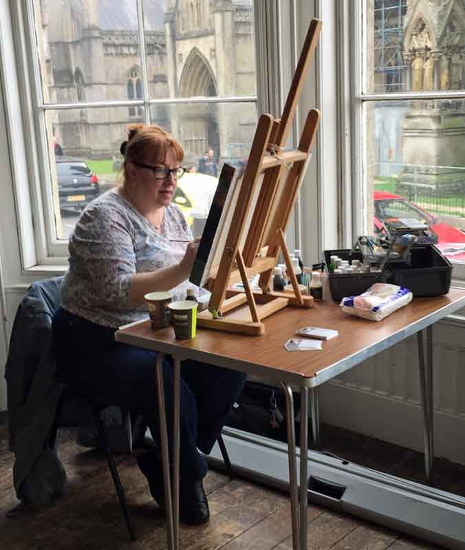 Jackie Burns demonstrating her painting technique.